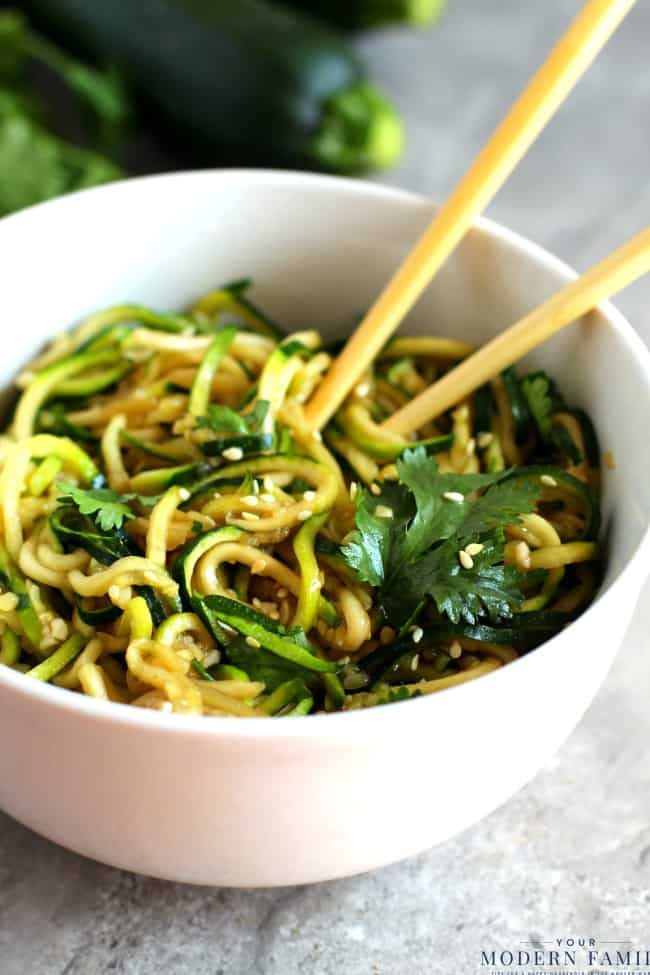 A bowl of zucchini noodles with chopsticks.