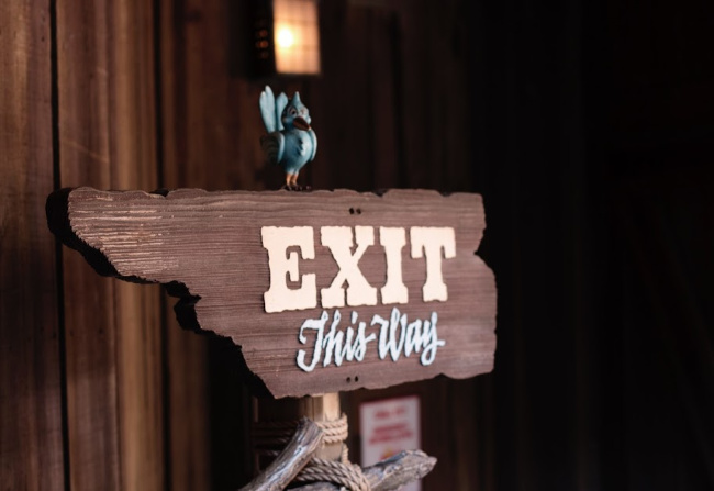 A wooden exit sign.