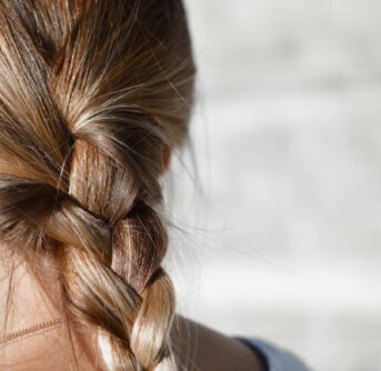 A close up of a girl's braided hair.