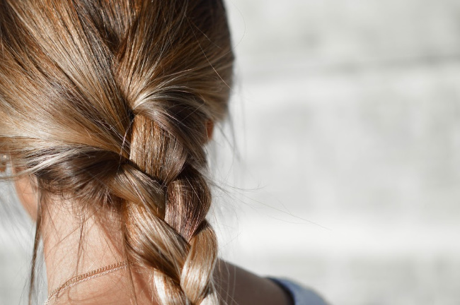 A close up of a girl\'s braided hair.