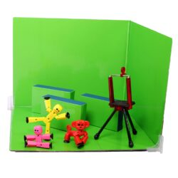 Small toys with a green background.