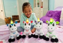 A group of stuffed animals with a smiling girl behind them.