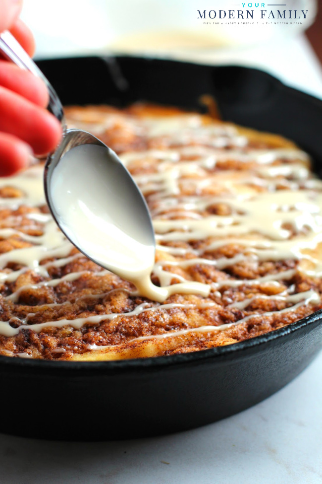 Pour the icing over the cinnamon roll skillet cake