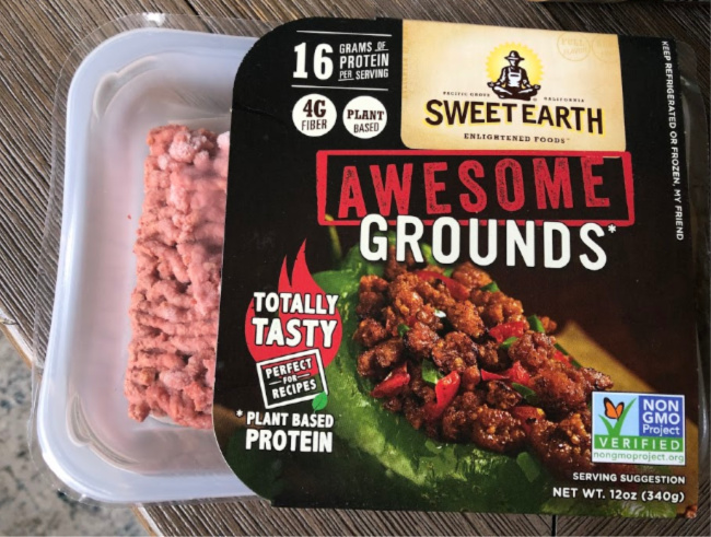 A close up of a container of food with Plant-based diet and Sweet Earth