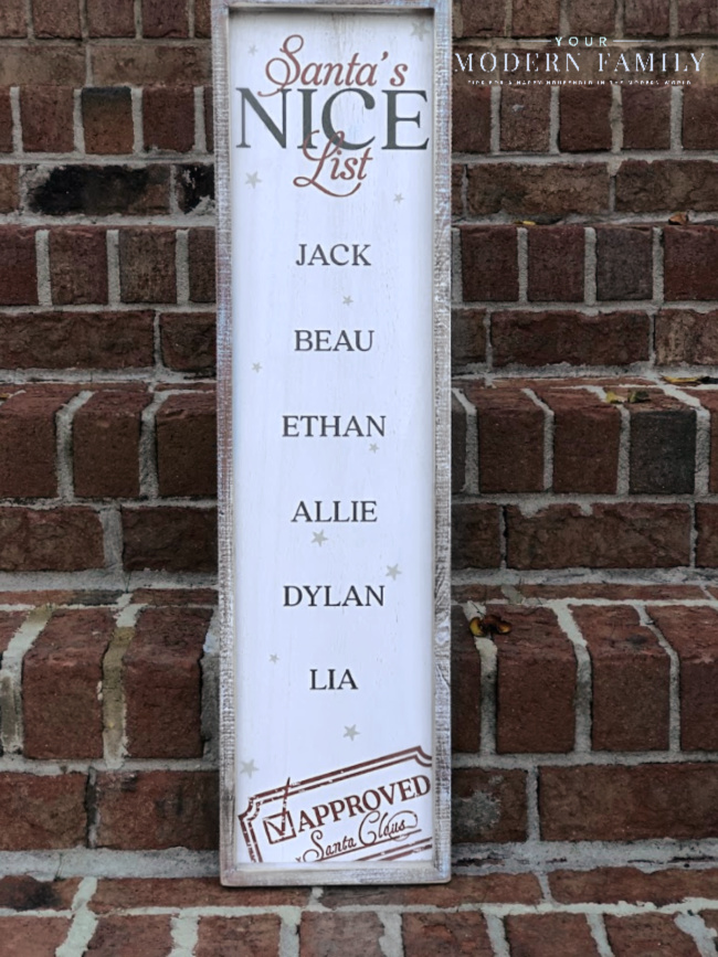 A sign in front of brick steps.