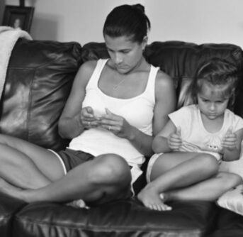 Mother & Child sitting pretending to be on phones