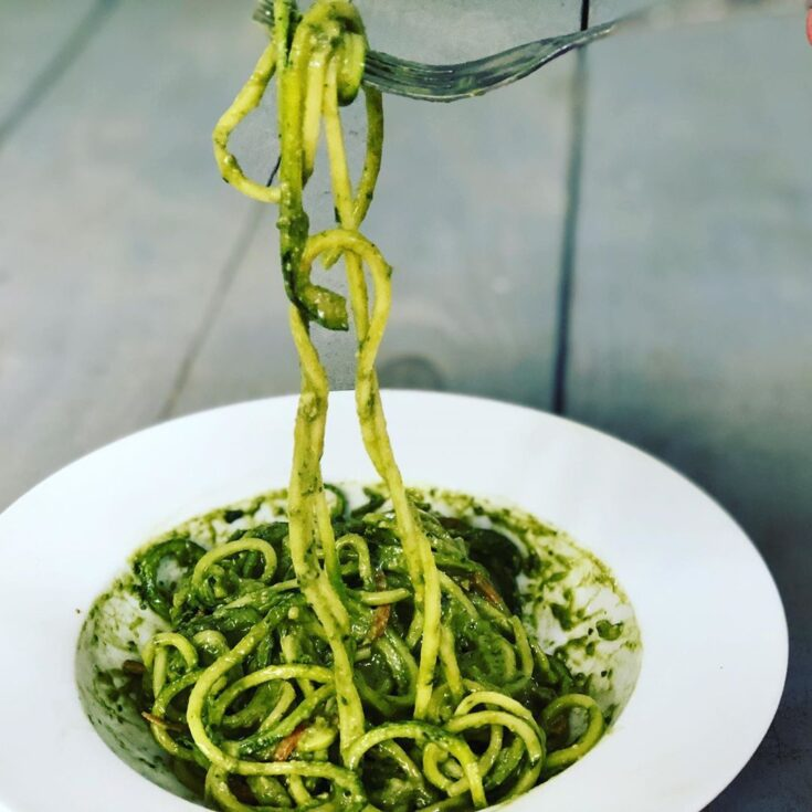 Avocado pesto sauce on raw zucchini noodles.