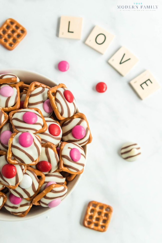 A close up of a bowl of chocolate pretzels for valentines snack.