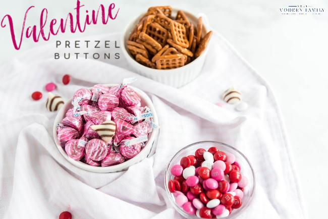 A bowl of camdy on a plate, with Pretzel and Valentine\'s Day treats.
