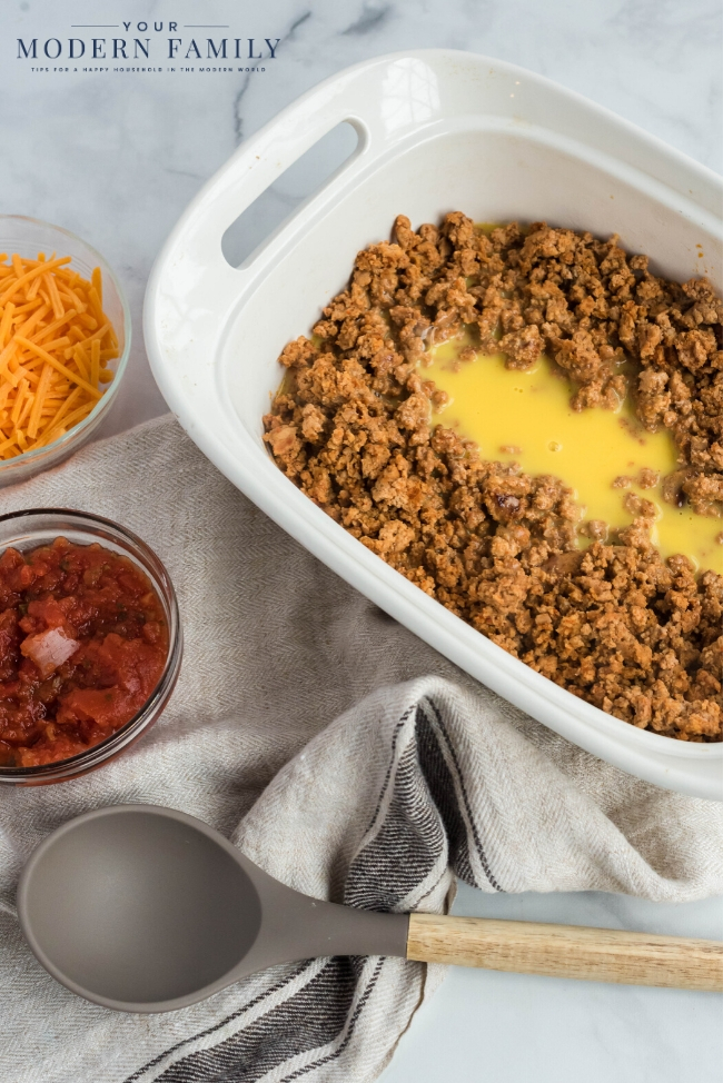 A bowl of food on a plate, with Taco and Casserole