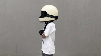 A child wearing a helmet