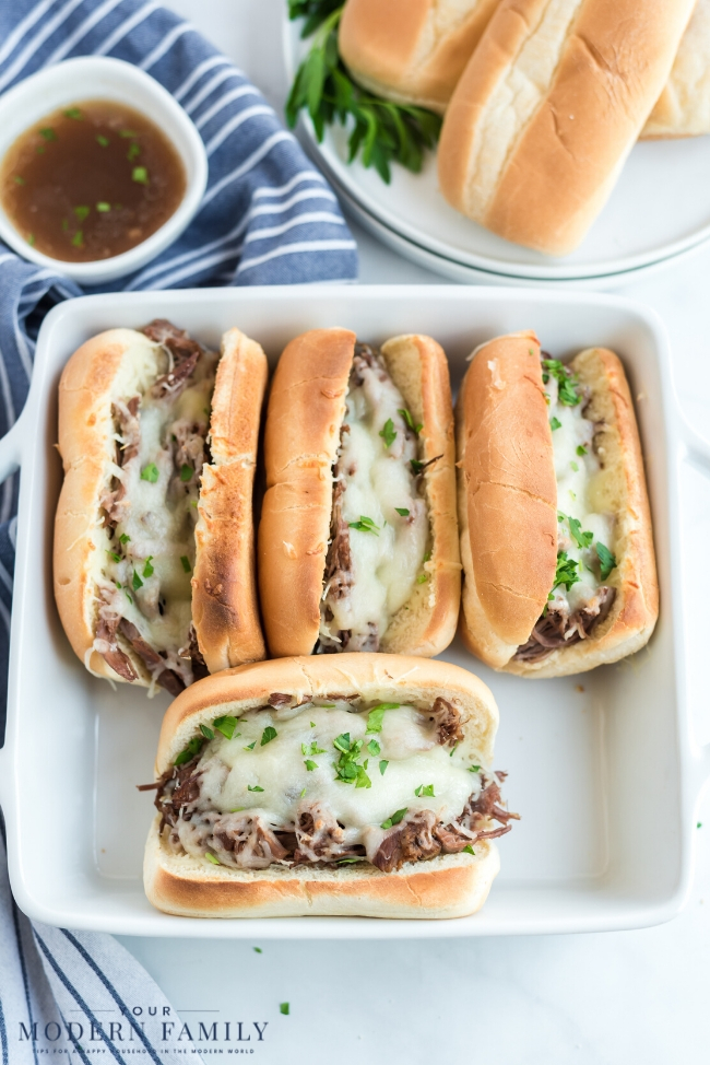 A tray of food on a plate with a hot dog, with Sandwich and French dip