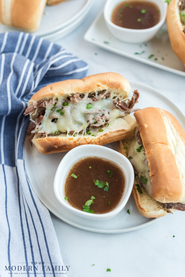 A tray of food on a plate, with Sandwich and French dip