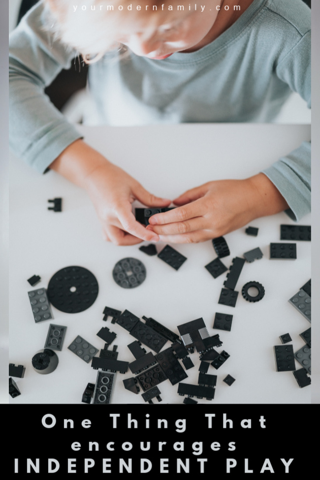 Kid building with blocks to encourage independent play