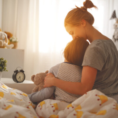 mom & child hugging as part of a morning routine