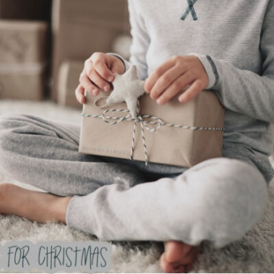 Child opening the 4 gifts for Christmas