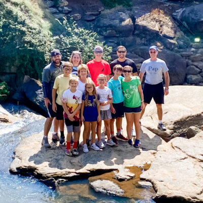 Our family together on a rock after biking