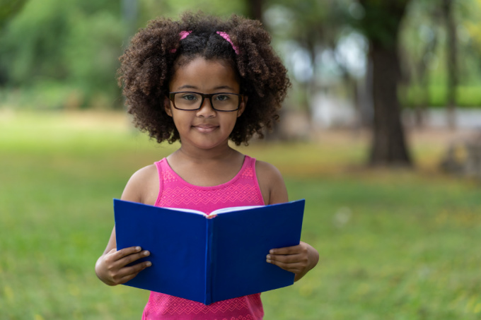 summer learning -child is reading book